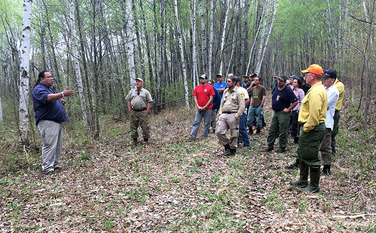 Terry Kemper instructing a field tour near St. Croix State Forest spring 2018.