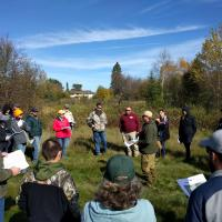 Participants gather and listen to presentation by Kevin Sheppard, American Bird Conservancy